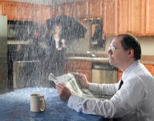 People in need of roof repair in Morning View KY. Leaky roof causing it to rain on people in their kitchen. Humorous.