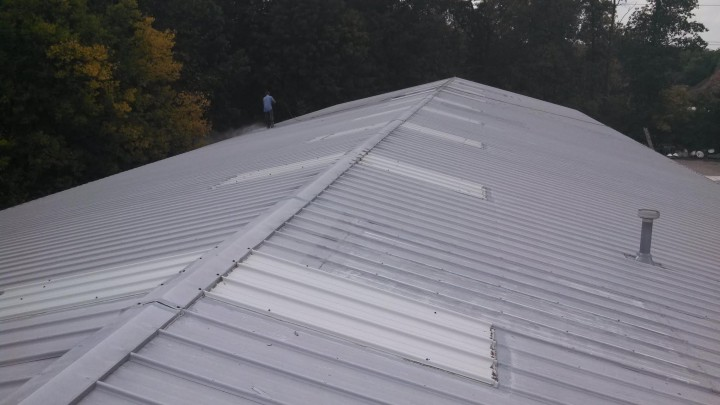 Roofer installing slate roof in West Union, OH.