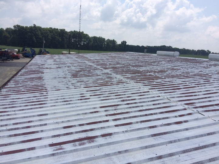 Before and After Commercial roofing servives Littles Farm Supply in Lynchburg Ohio